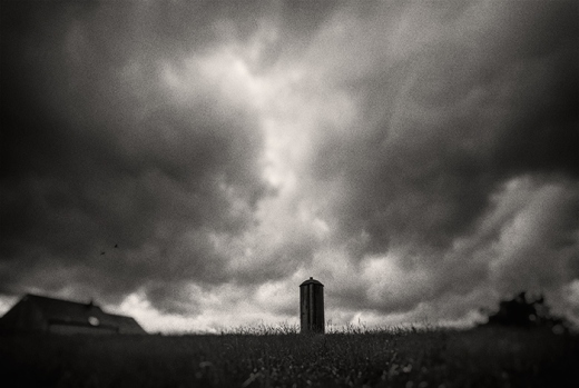 silo-clouds-grass-bw